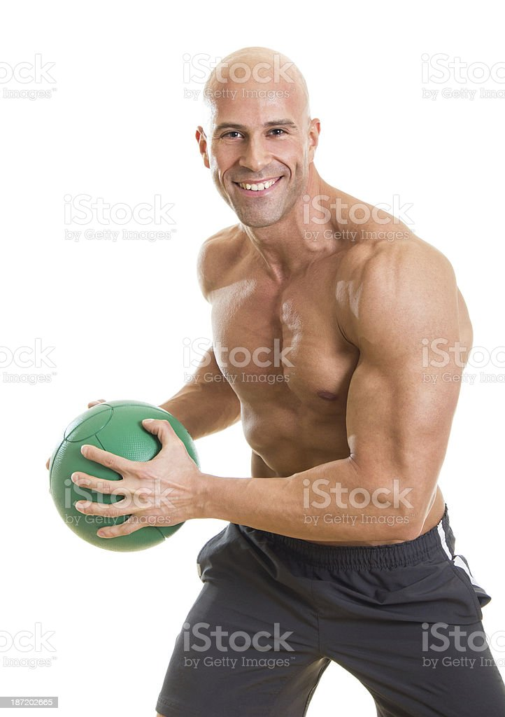 Strong man posing with basketball royalty-free stock photo