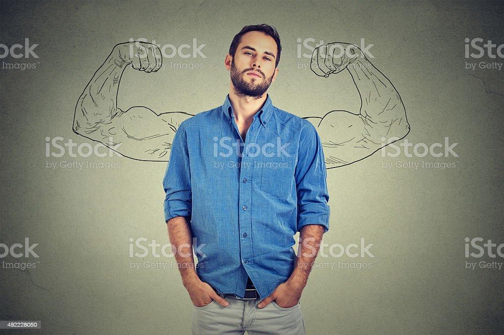 Strong man, self confident young entrepreneur stock photo