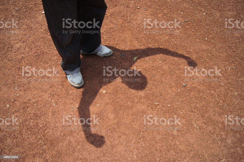 Strong Man shadow on the ground stock photo