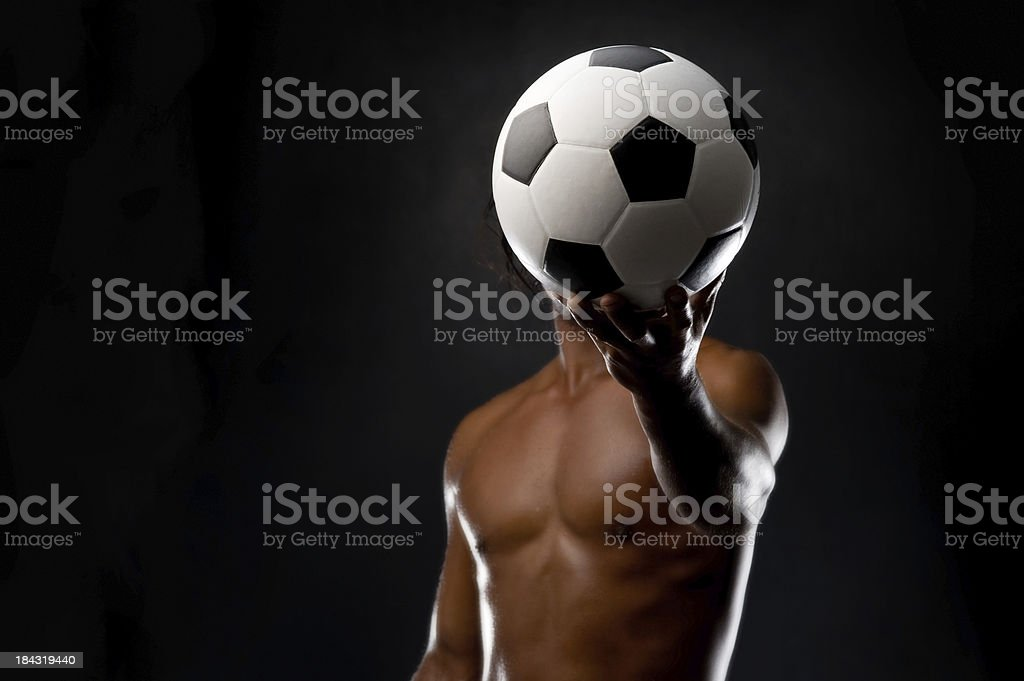 Strong man with soccer ball. royalty-free stock photo
