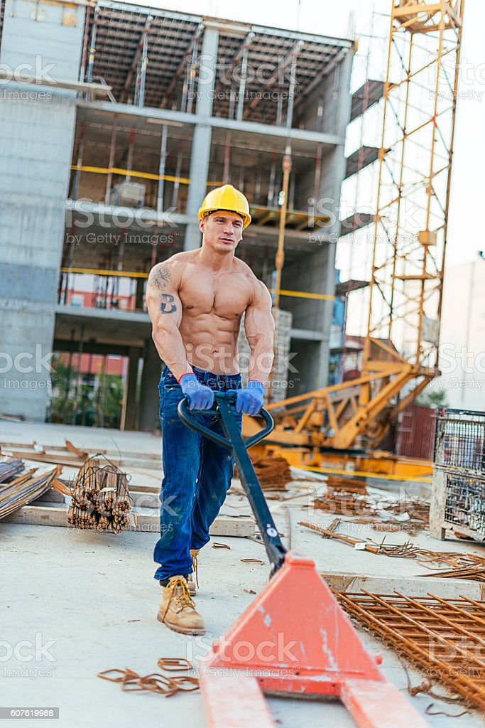 Image of construction worker on construction site, working on site...