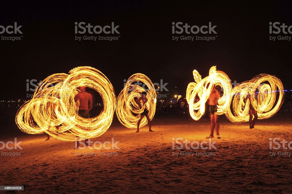 Strong Men Juggling Fire in Thailand stock photo