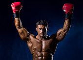 Strong muscular boxer in red boxing