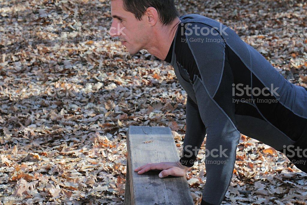 Strong muscular man push ups plank workout stock photo