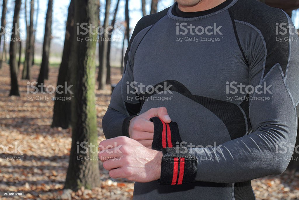 Strong muscular man workout outdoor on cold fall winter day. stock photo