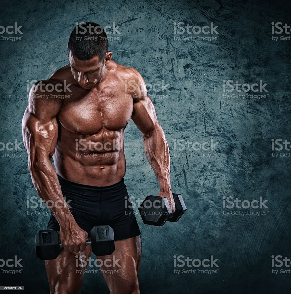 Strong, Muscular Men With Dumbbells stock photo