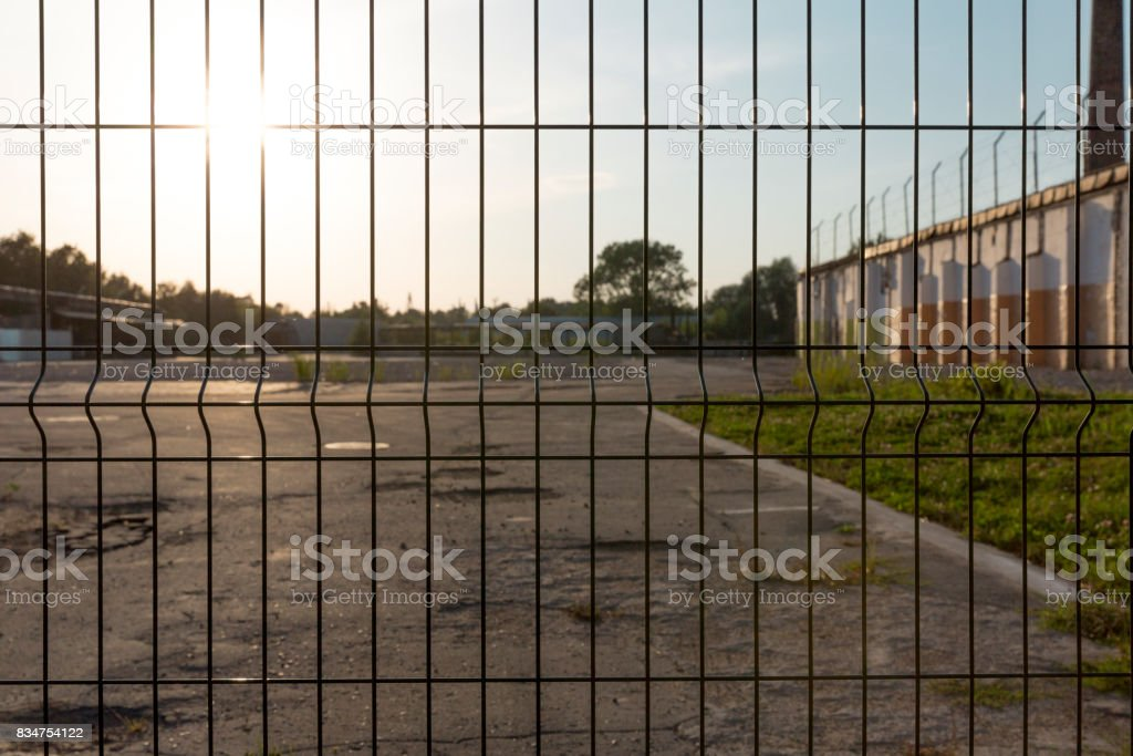 Strong, safe Industrial fencing made of heavy duty metal wire stock photo