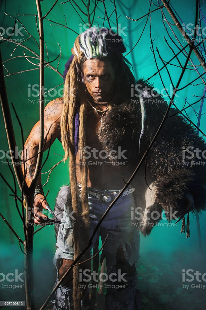 Strong scary werewolf walking in the woods stock photo