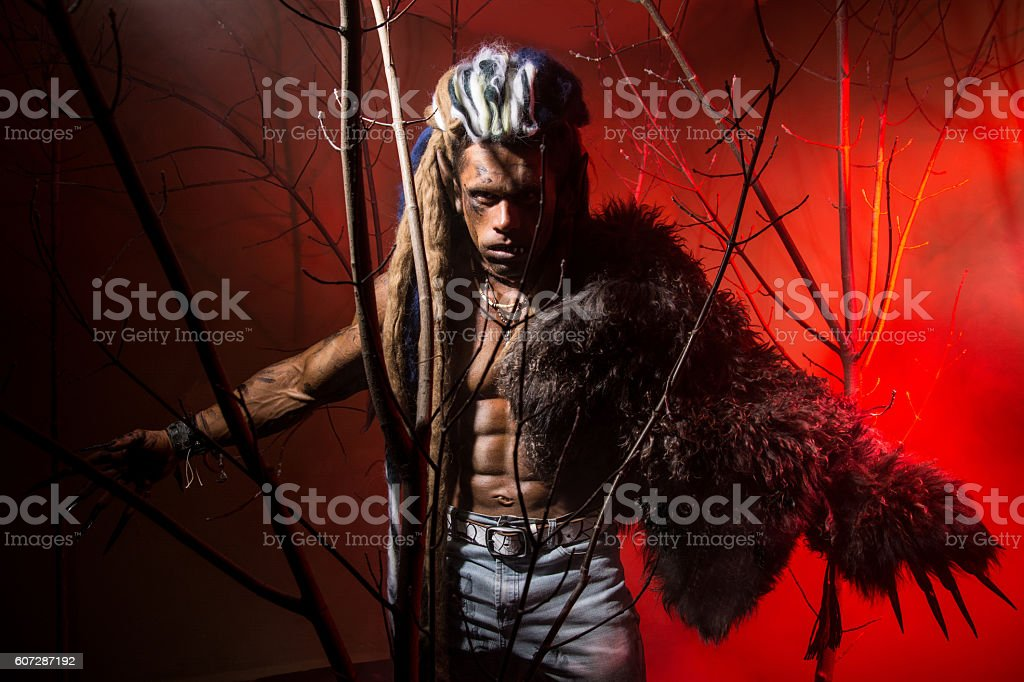 Strong scary werewolf with long nails in the wood. stock photo
