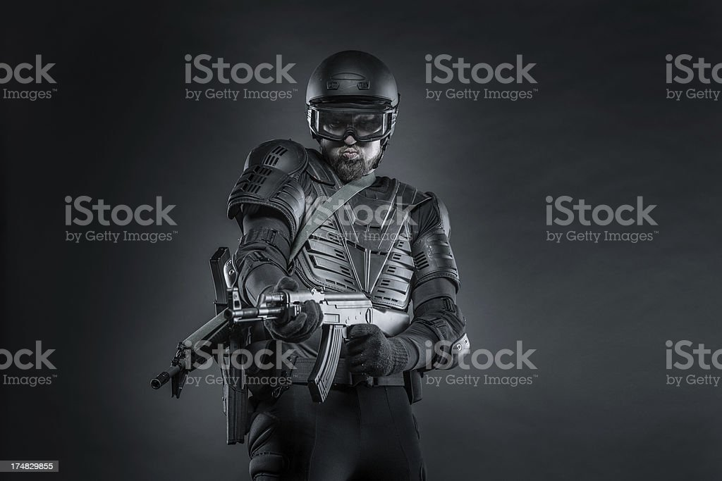 Strong Soldier in Military Armor Ready for Action royalty-free stock photo