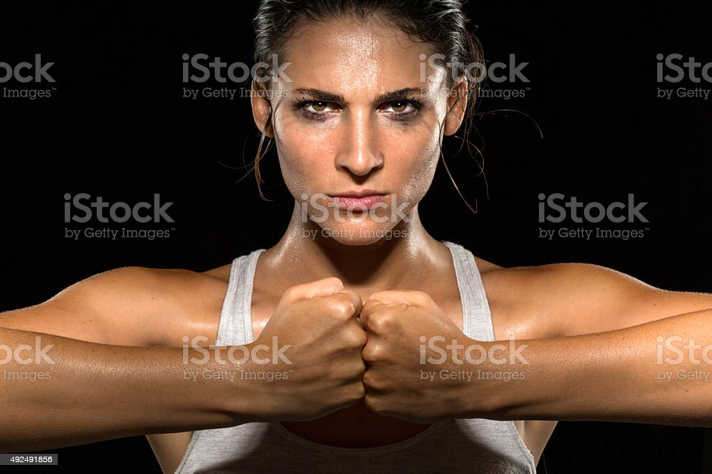 Strong strength confidence power determination relentless conviction female athlete trainer stock photo