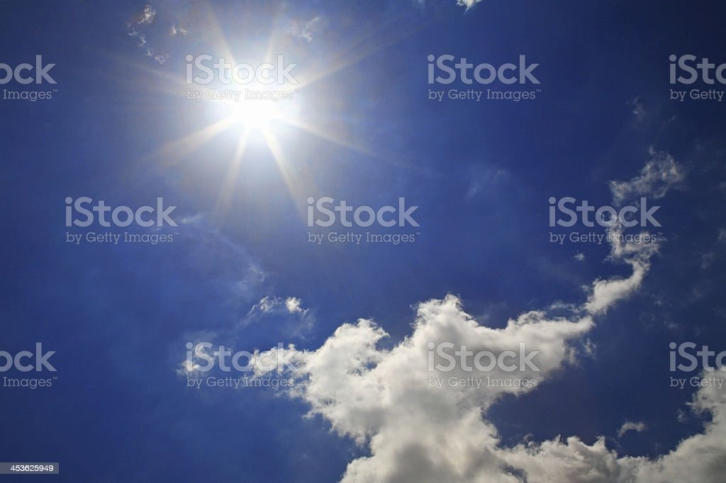 Strong sun and beautiful clouds royalty-free stock photo