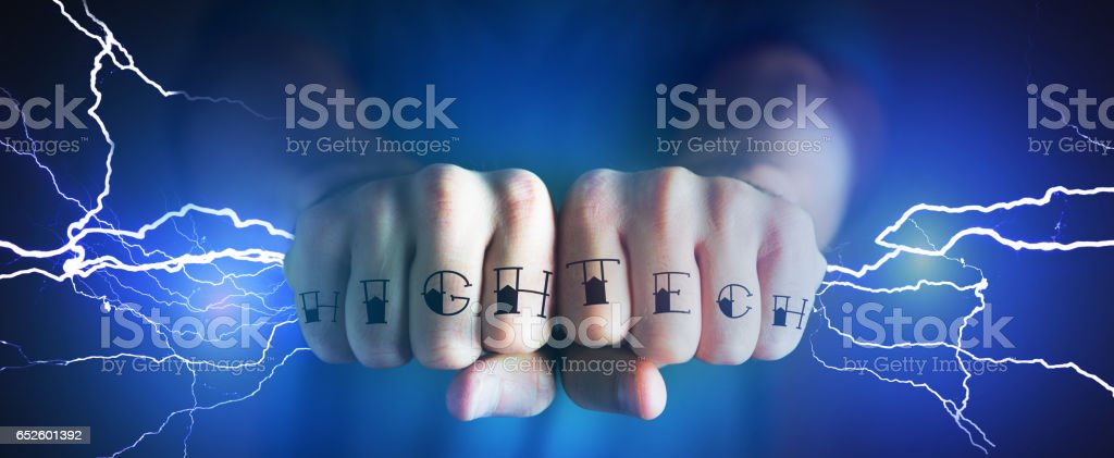 Strong tattooed hands catching thunders bolt - Power concept stock photo