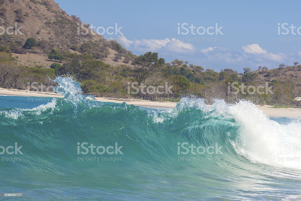 Strong waves crash over the beach stock photo