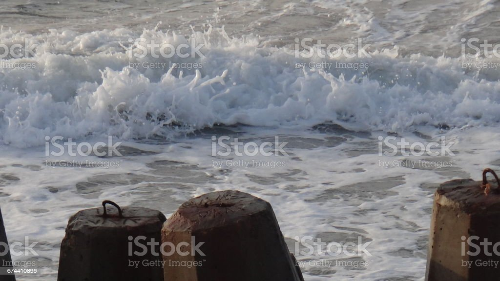 Strong waves towards the rocks stock photo
