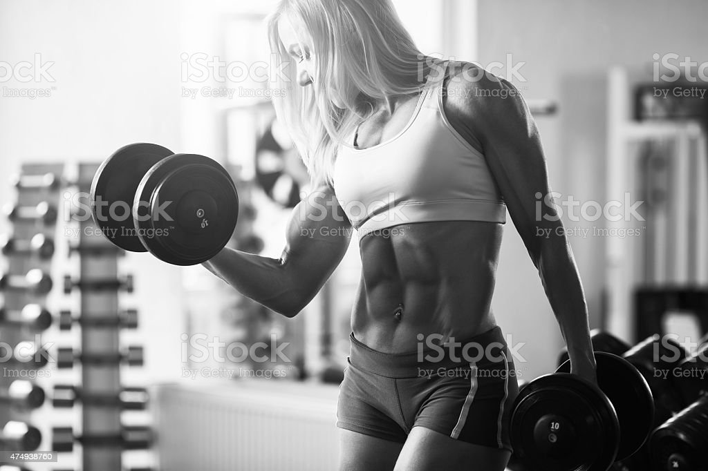 Strong woman bodybuilder stock photo