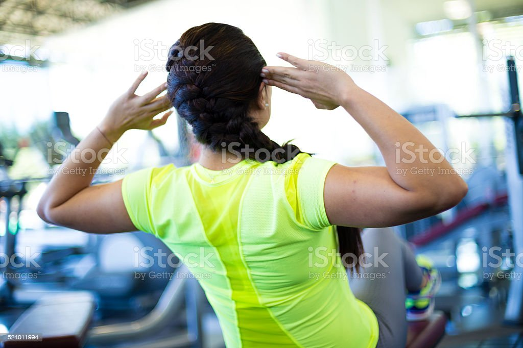Strong woman doing abs at the gym stock photo