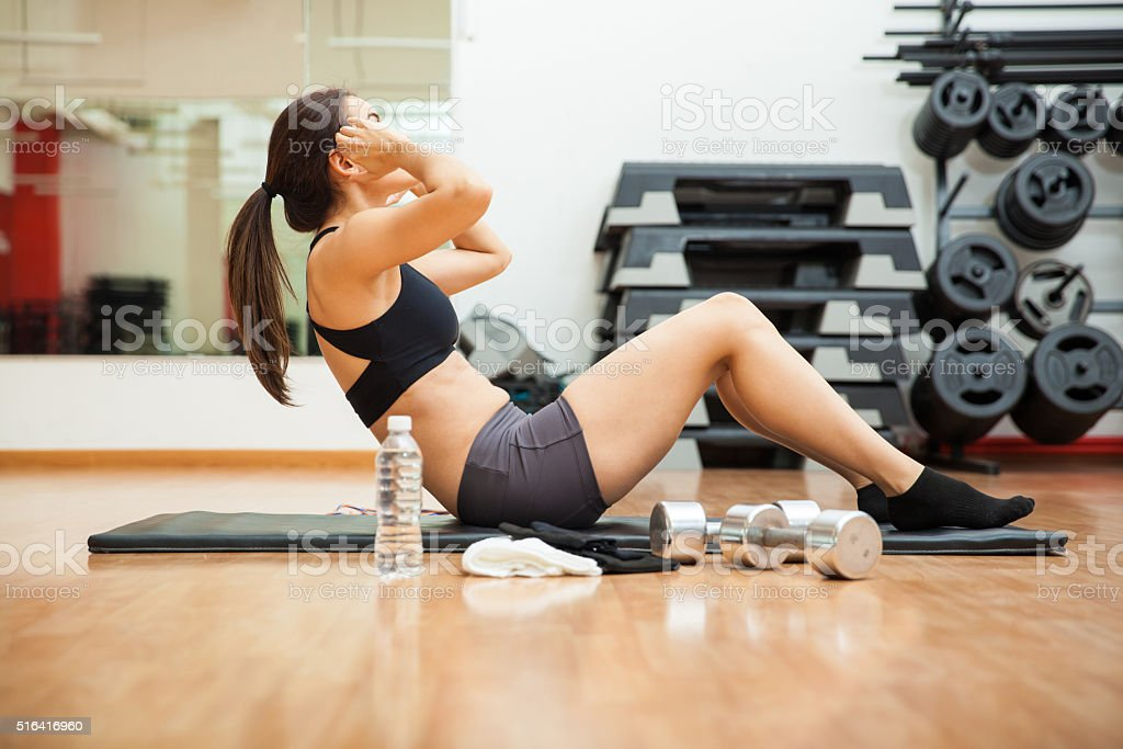 Strong woman doing crunches at the gym stock photo