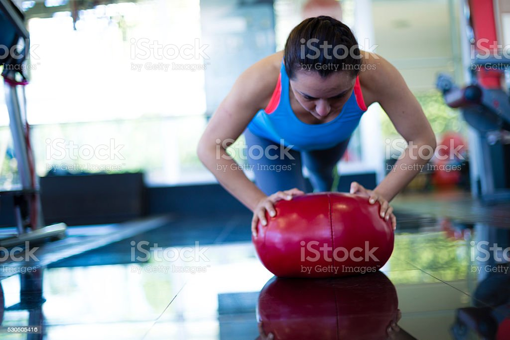 Strong woman doing push ups stock photo