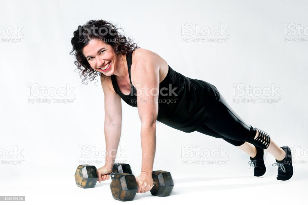 Strong Woman Dumbbell Plank stock photo