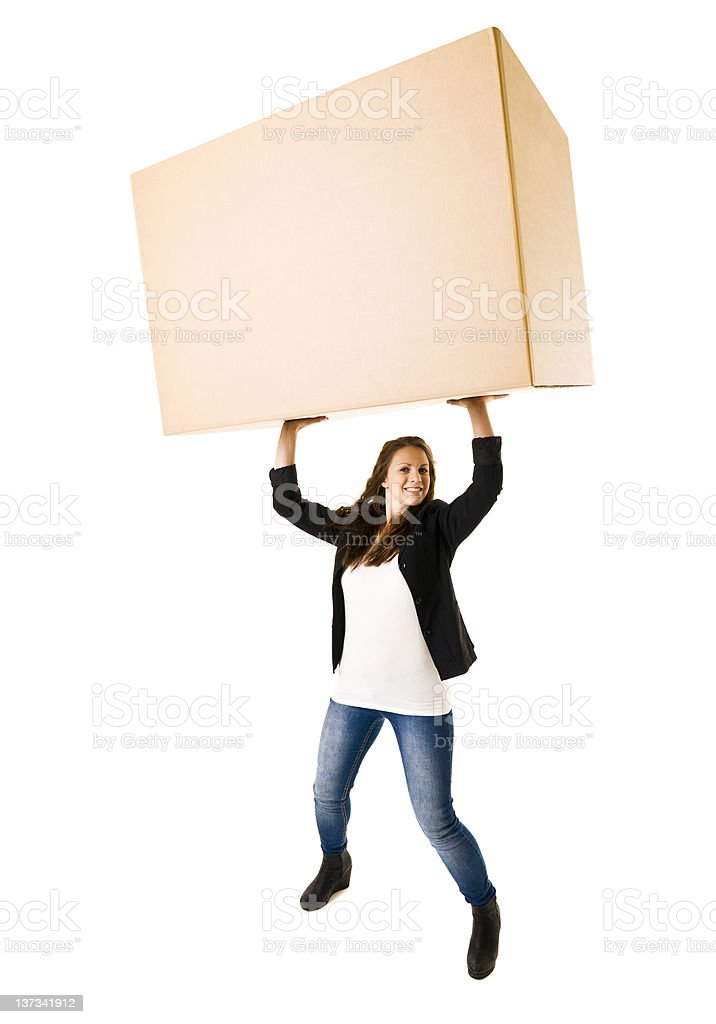 Strong woman in casual clothes, lifting a box stock photo