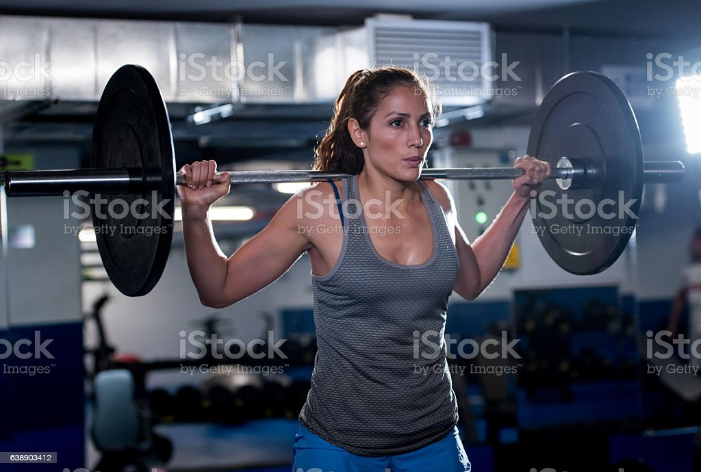Strong woman weightlifting stock photo