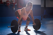 Strong woman weightlifting