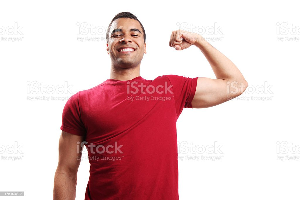 Strong young guy flexing his biceps royalty-free stock photo