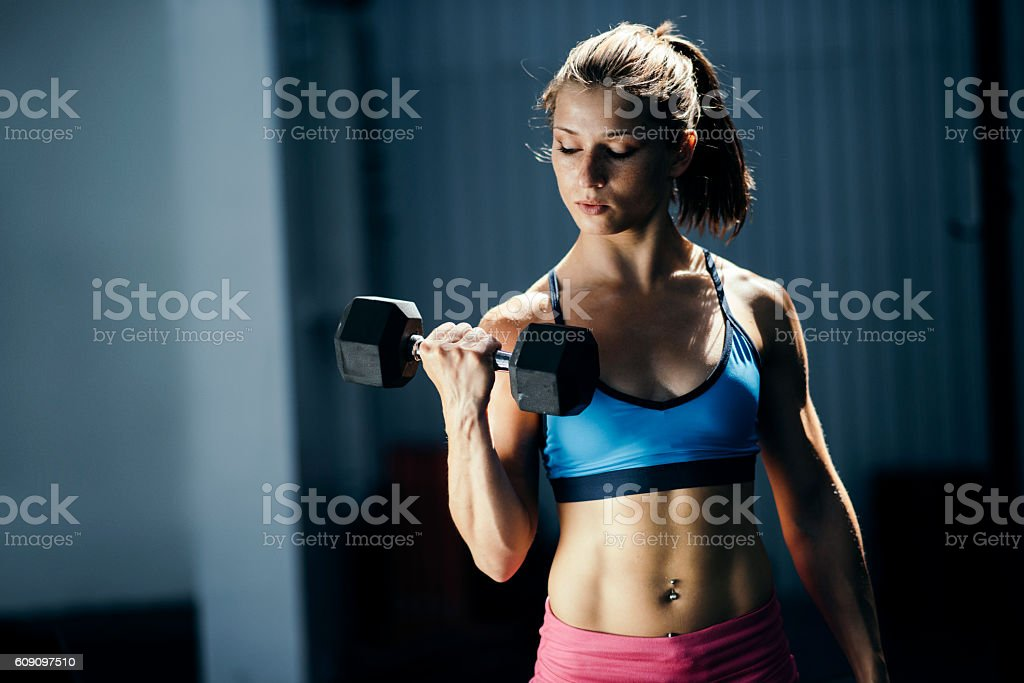 Strong young woman stock photo