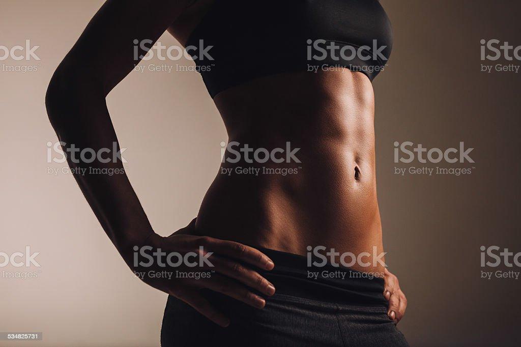 Strong young woman torso stock photo