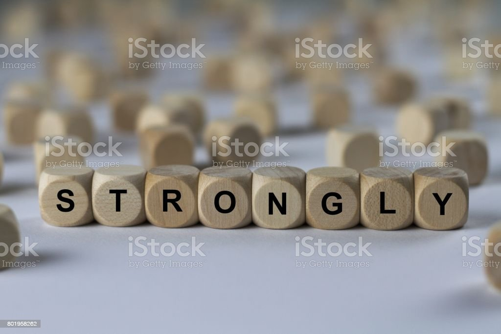 strongly - cube with letters, sign with wooden cubes stock photo