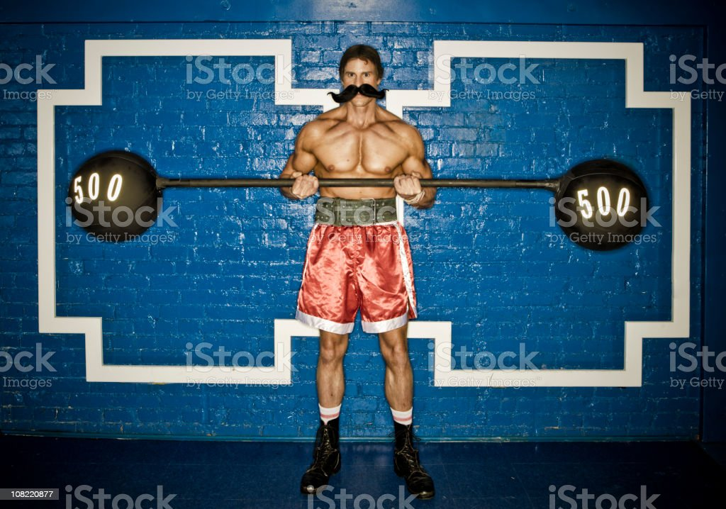 Strongman lifting weight royalty-free stock photo