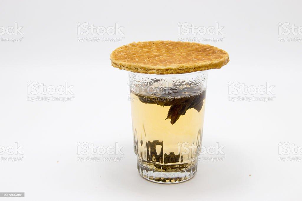 stroopwafel on hot tea glass stock photo