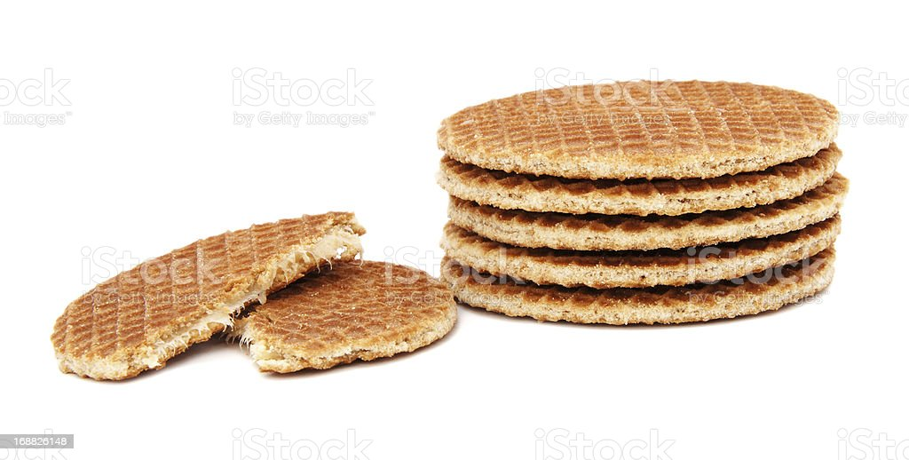 Stroopwafels, Dutch caramel waffles piled up, with one broken in royalty-free stock photo