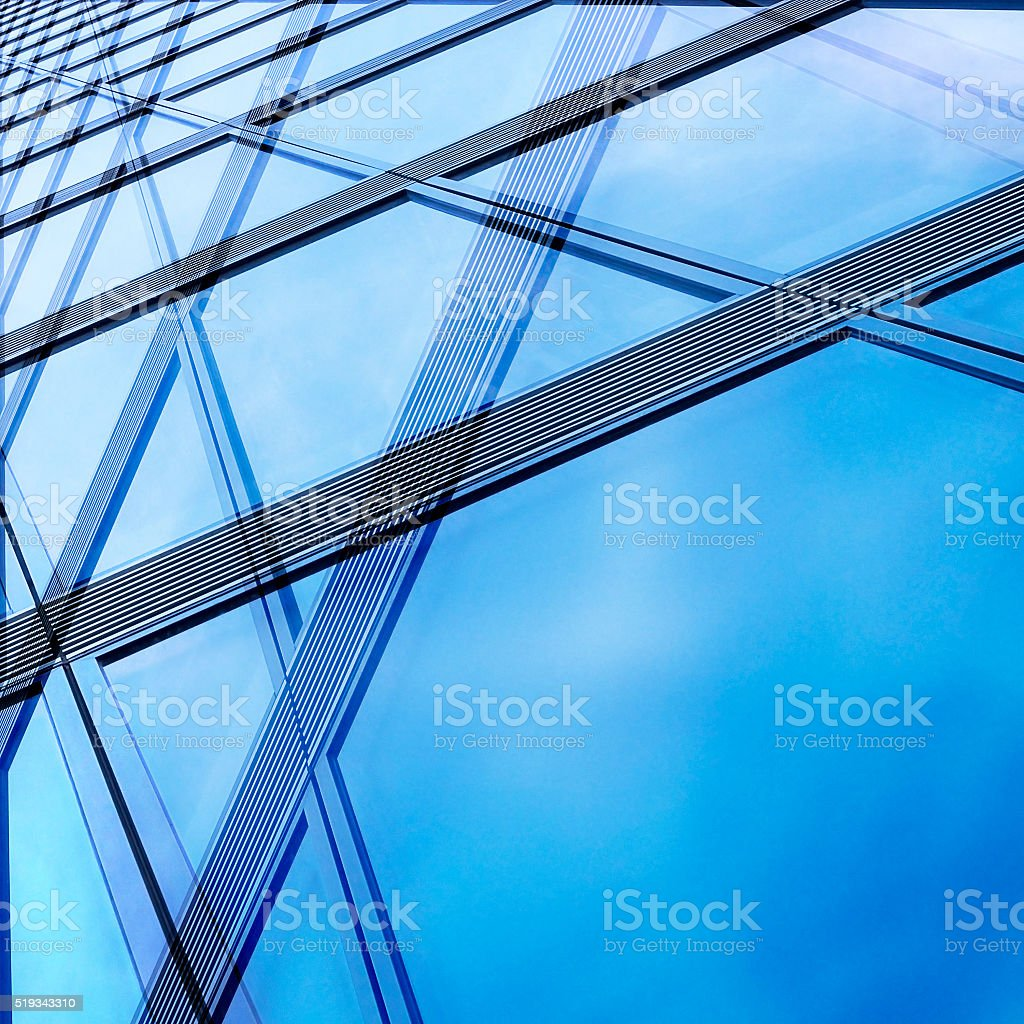 Structural / modular glass wall reflecting bright sky stock photo