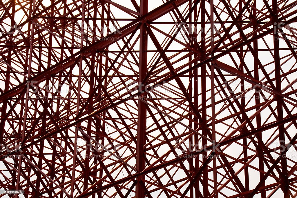 Structural orange steel cross construction abstract background stock photo