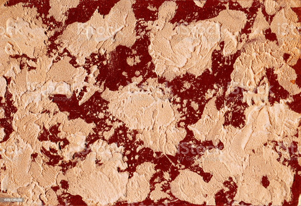 Structural plaster red wall, background texture stock photo