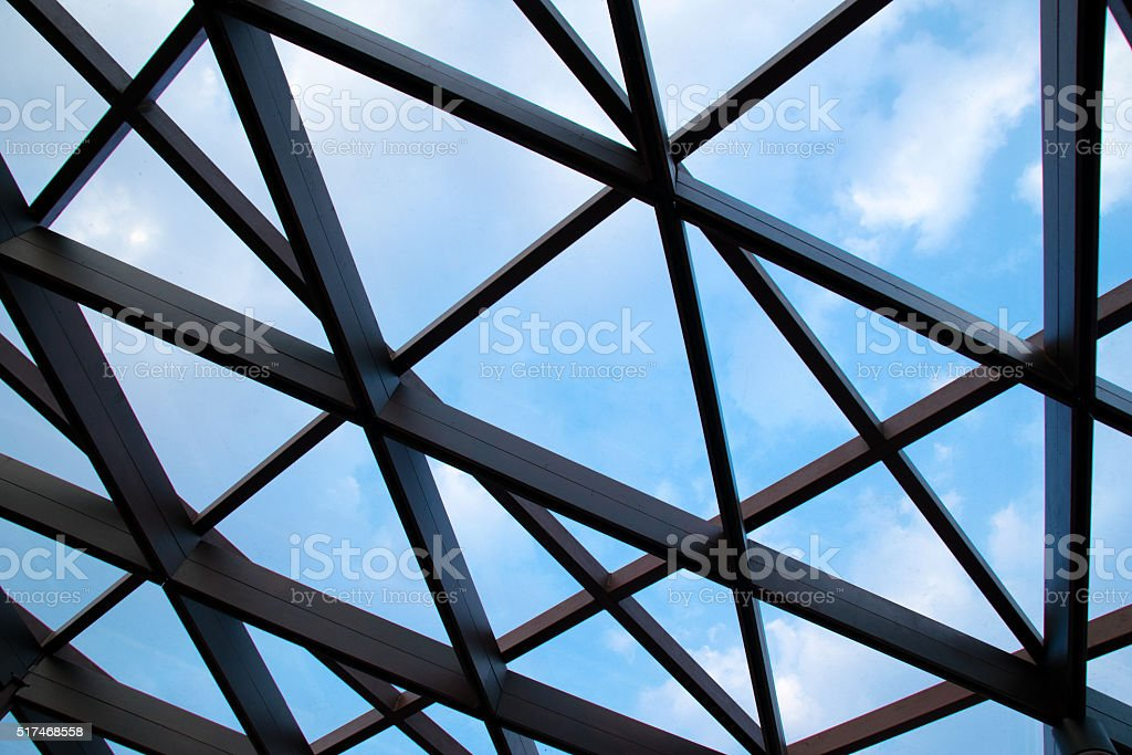 Structural steel cross construction and Cloud sky stock photo