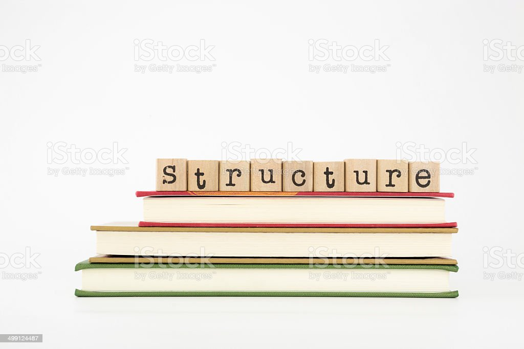 Structure word on wood stamps and books stock photo
