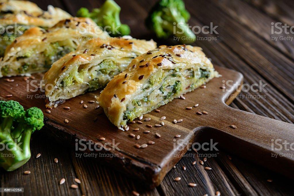 Strudel stuffed with broccoli, Mozzarella and onion stock photo