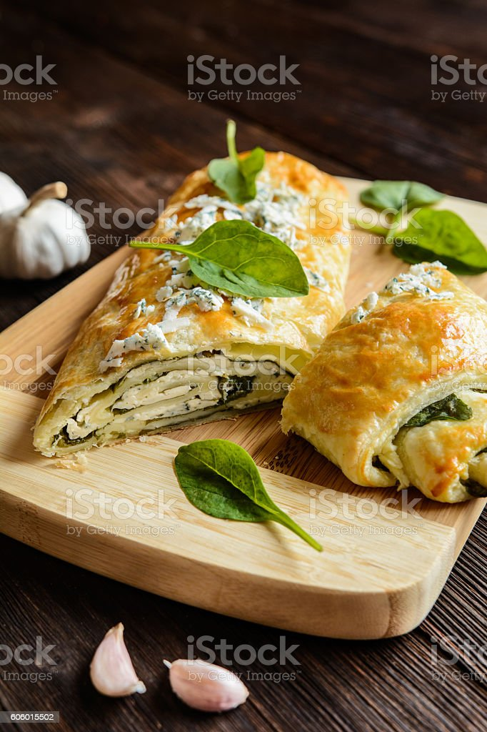Strudel stuffed with spinach, cheese and garlic stock photo