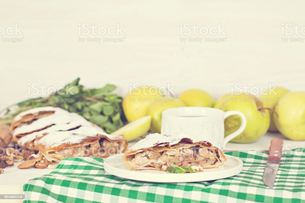 Strudel with apples and nuts. stock photo