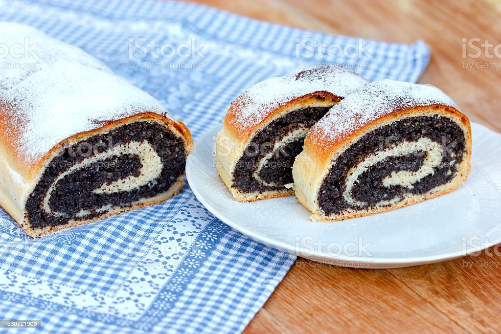 Strudel with poppy seeds on table stock photo