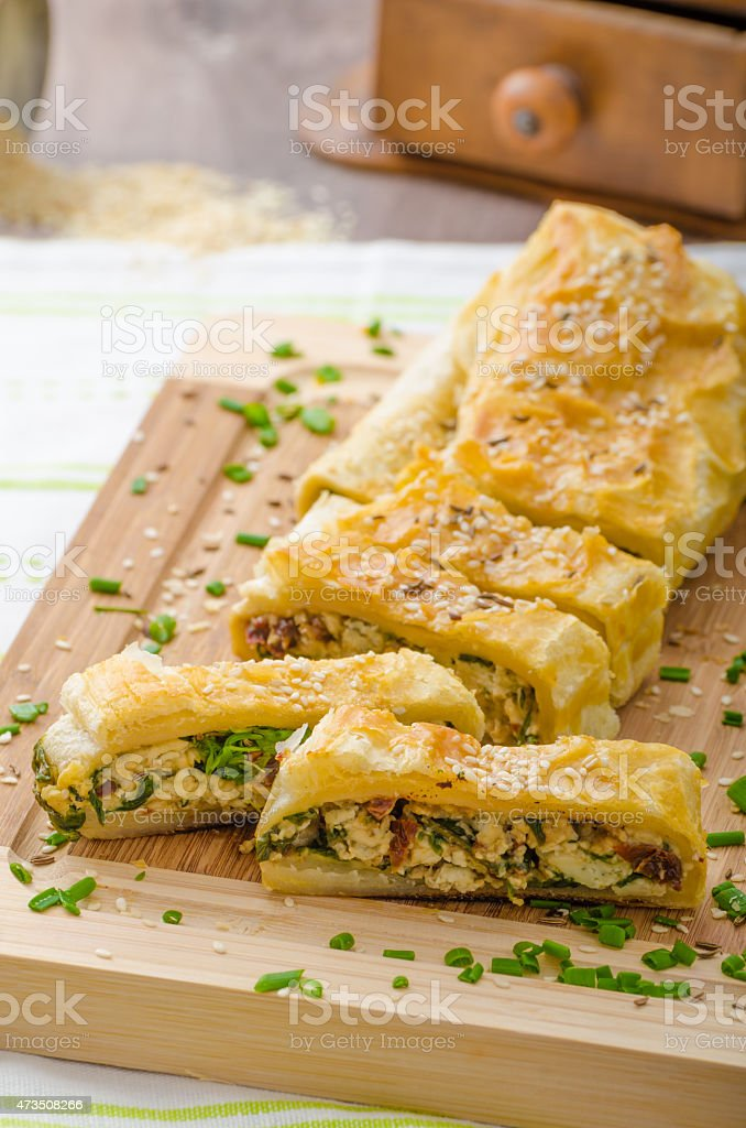 Strudel with spinach, blue cheese and garlic stock photo