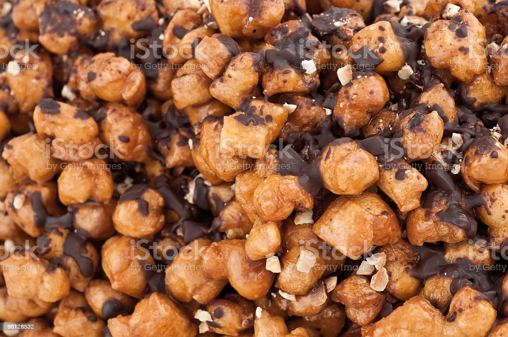 Struffoli in honey with chocolate and almond bits (Full Frame) stock photo