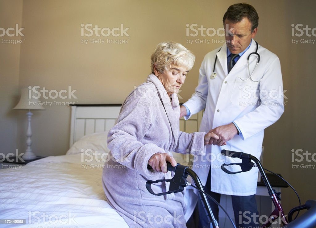Struggle for mobility in her old age royalty-free stock photo