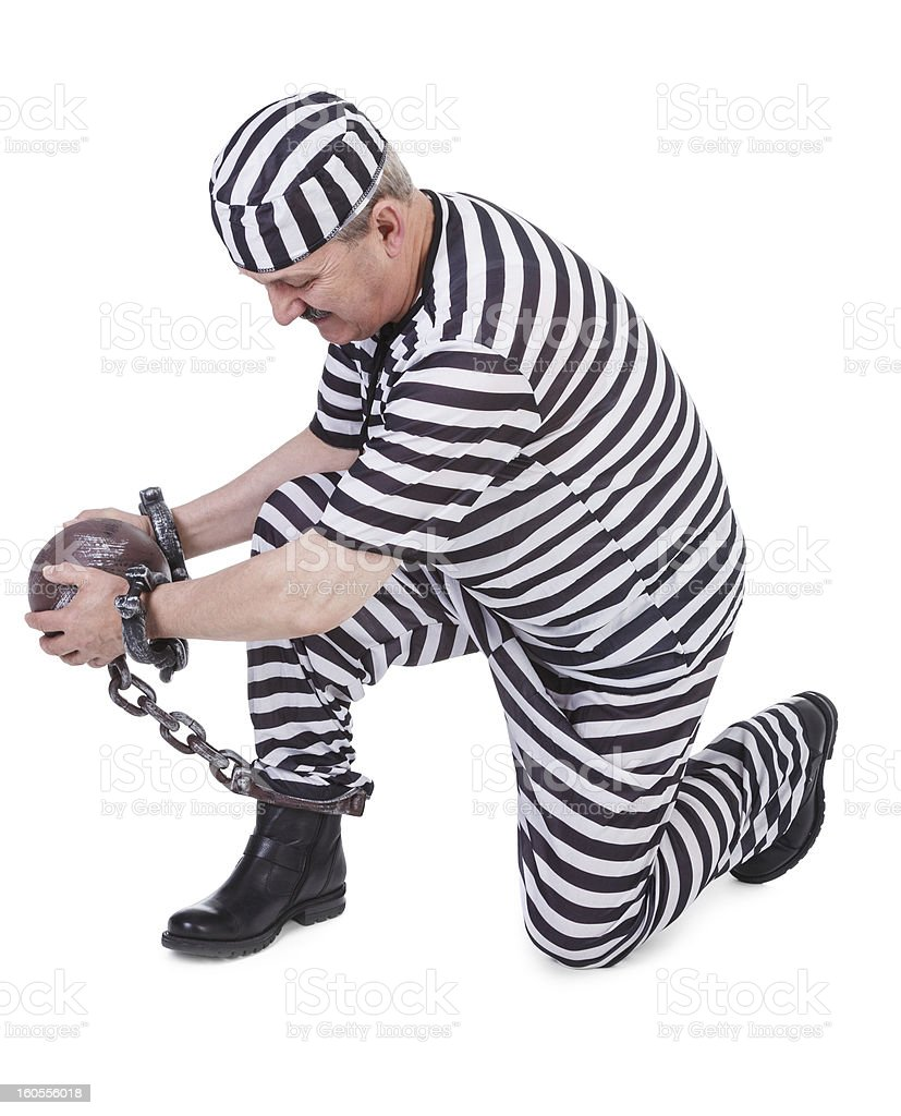 struggle with ball and chain royalty-free stock photo