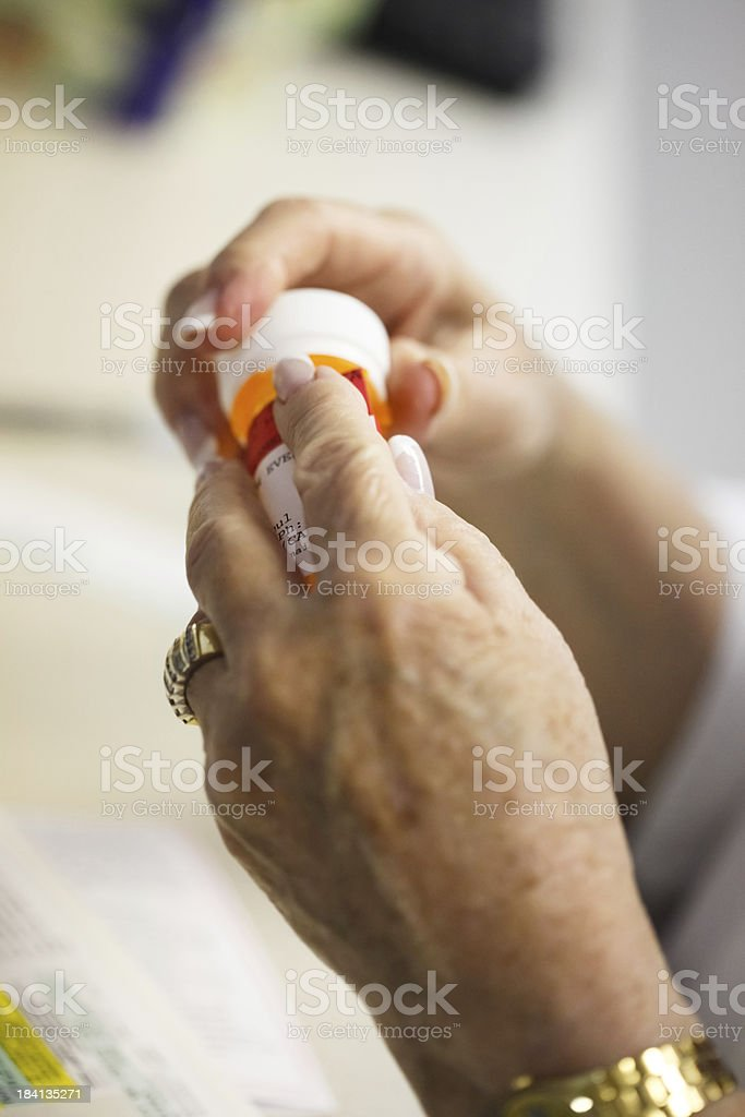 Struggling to get the cap open stock photo