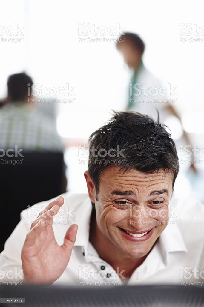 Struggling to meet his deadline royalty-free stock photo