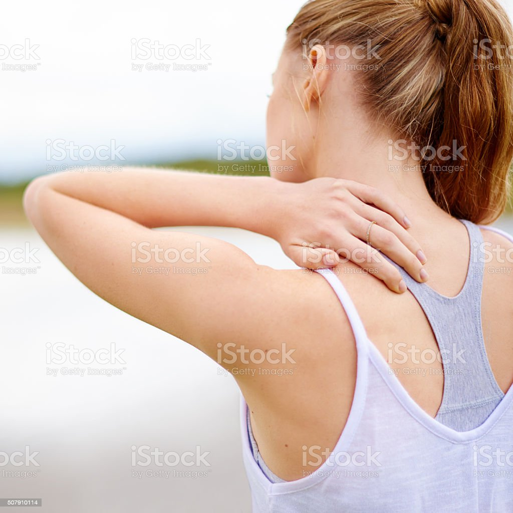 Struggling with a stiff neck stock photo